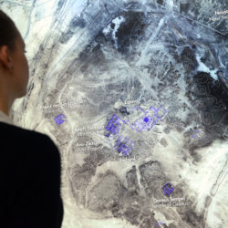 An employee looks at an archaeological map at the exhibition 'Uruk - 5,000 Years Megacity' at the LWL Museum for archaeology in Herne, Germany, 31 October 2013. CAROLINE SEIDEL