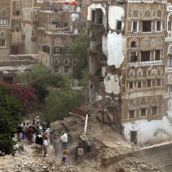 Yemenis search for survivors under the rubble of old buildings destroyed by an airstrike in the old city of Sana'a, Yemen. 12 June 2015. EPA/ Yahya Arhab